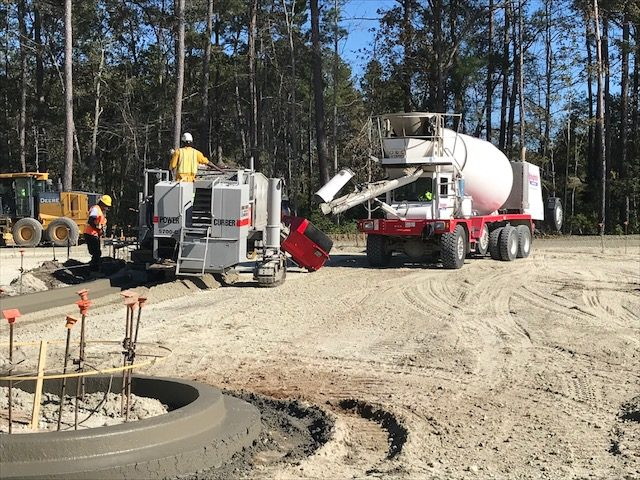 concrete truck supplying curber