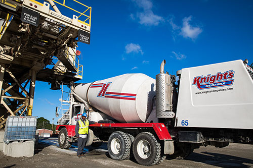 Redi-mix concrete truck at loading station