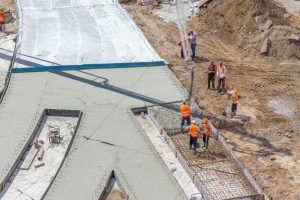 Workers preparing a site for concrete