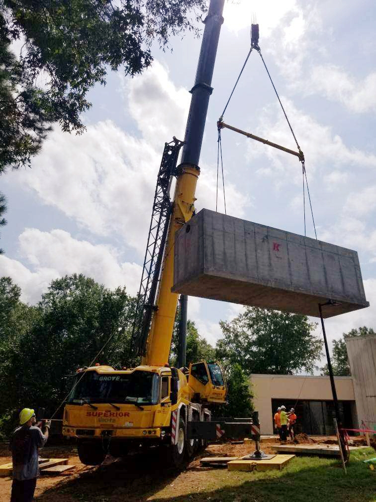 Settling box being placed by a crane