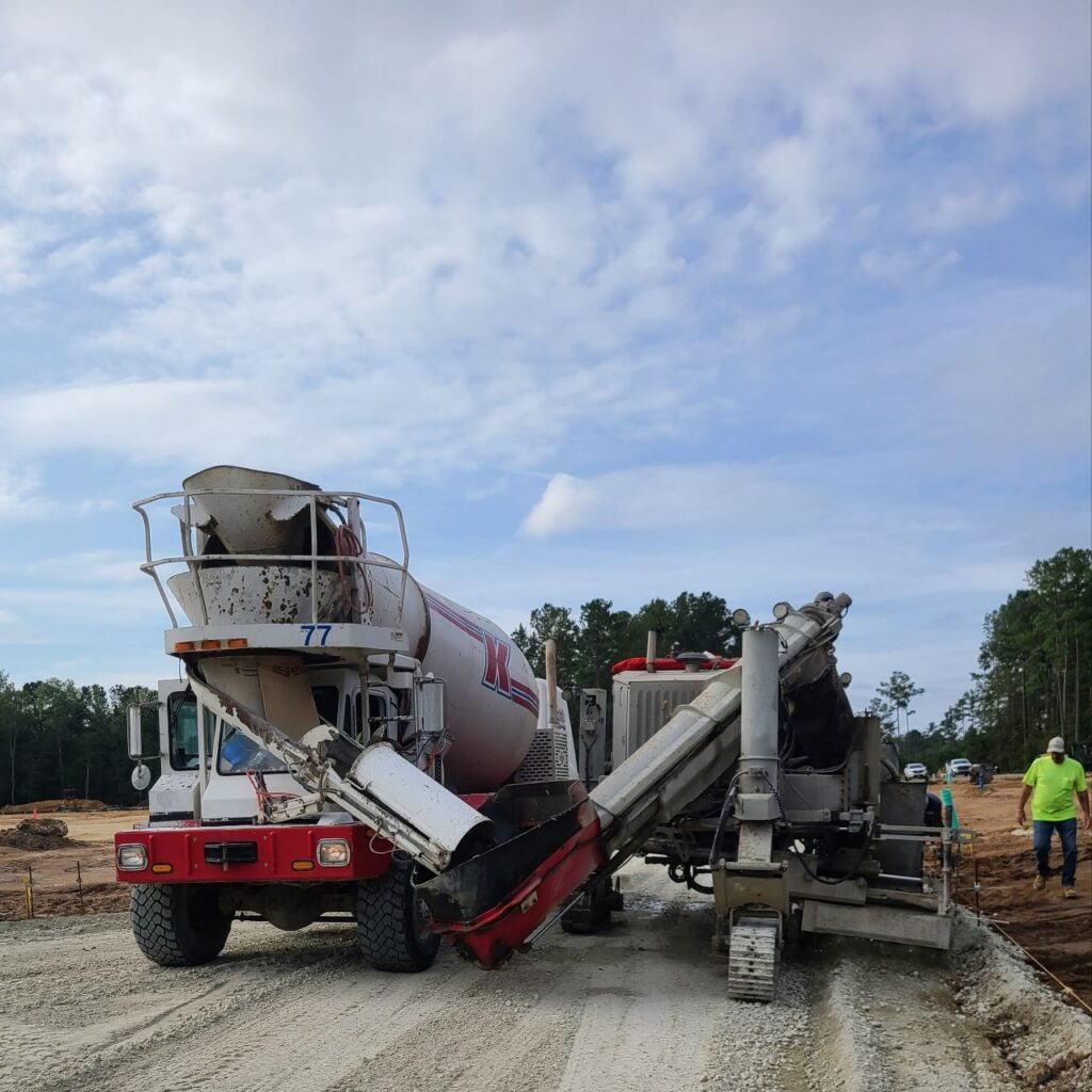 Mixer pulled up next to curb machine