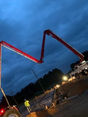 Pump truck boom extended at Family Dollar site